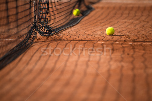 Tennis court with tennis balls and the net Stock photo © lightpoet