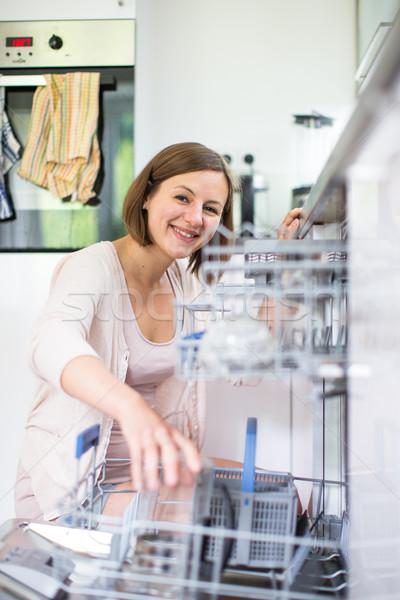 Fiatal nő modern konyha lány boldog otthon Stock fotó © lightpoet