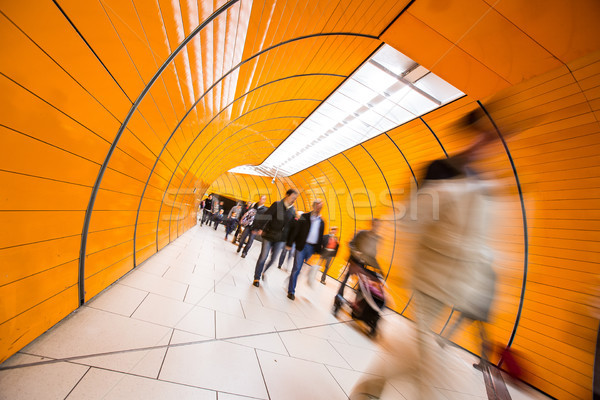 Stock photo: People rushing through a subway corridor