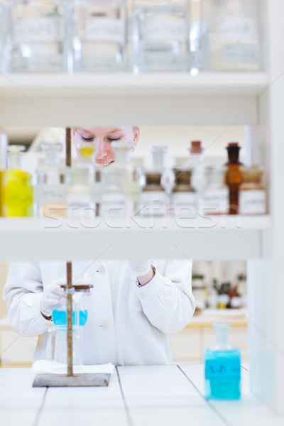 female researcher carrying out research in a chemistry lab Stock photo © lightpoet