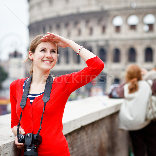 Stock photo: Portrait of a pretty young tourist sightseeing in Rome, Italy