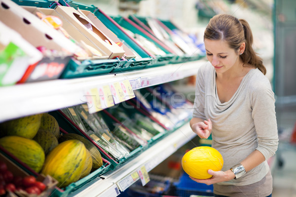 Stock photo: Pretty, young woman shopping for fruits and vegetables