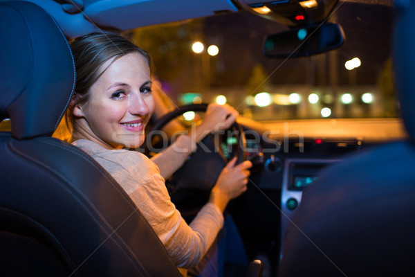 Pretty young woman driving her new car at night  Stock photo © lightpoet