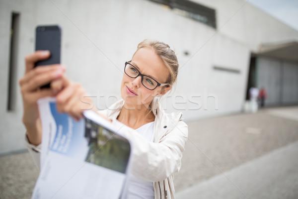 Pretty, female tourist taking a selfie picture  Stock photo © lightpoet