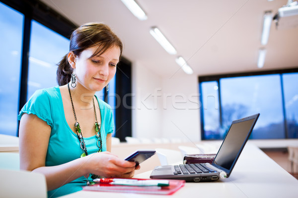 Pretty young female student with laptop on /university  campus Stock photo © lightpoet