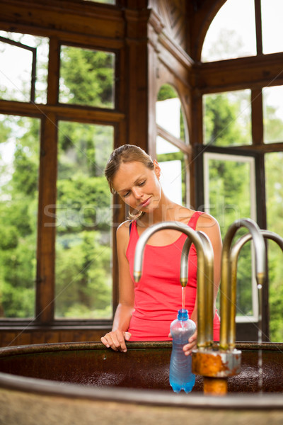 Genç kadın plastik şişe sağlıklı maden suyu spa Stok fotoğraf © lightpoet