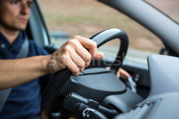 Male driver's hands driving a car on a highway Stock photo © lightpoet