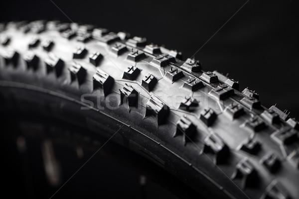 Modern MTB race mountain bike tyre isolated on black background  Stock photo © lightpoet