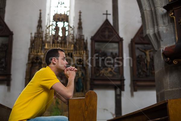 ハンサム 若い男 祈っ 教会 顔 祈る ストックフォト © lightpoet