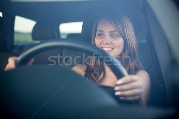 Cute teenager driving her brand new car Stock photo © lightpoet