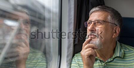 Senior man enjoying a train travel Stock photo © lightpoet