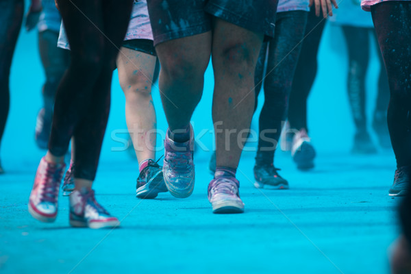People participating in the Color Run - Runners' legs amid blue  Stock photo © lightpoet