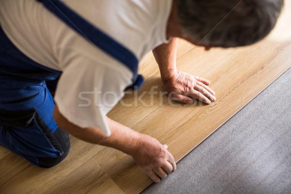 close up of male hands lying parquet floor board/laminate flooring Stock photo © lightpoet