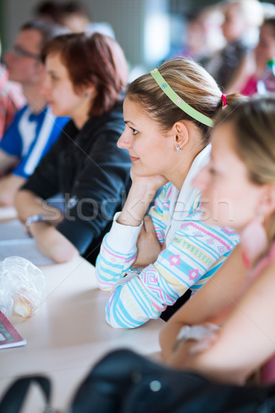 young, pretty female college student sitting in a classroom Stock photo © lightpoet