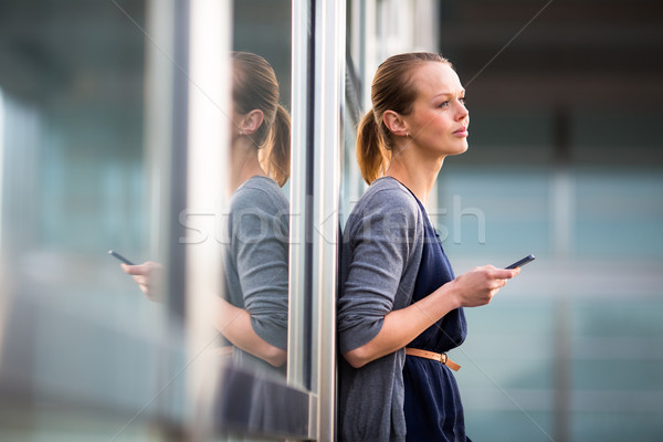 Portrait of a sleek young woman calling on a smartphone  Stock photo © lightpoet