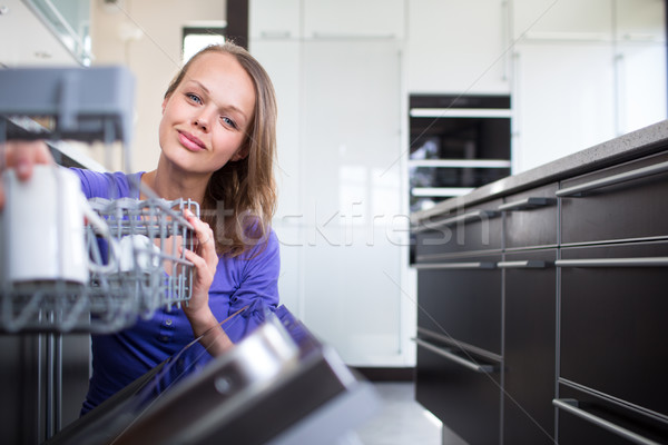 Pretty, young woman in her modern and well equiped kitchen  Stock photo © lightpoet