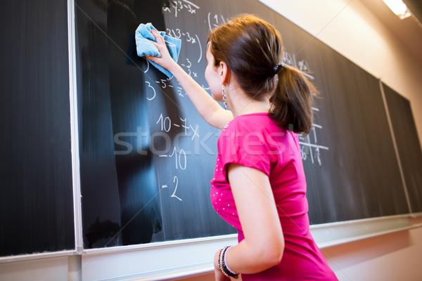Csinos fiatal főiskolai hallgató ír tábla matematika Stock fotó © lightpoet