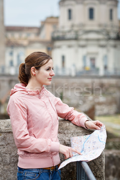 Pretty young female tourist studying a map at the Trajan's forum Stock photo © lightpoet