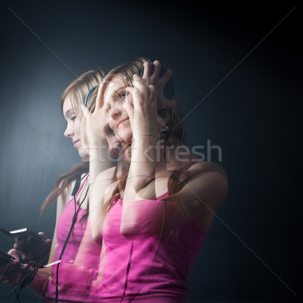 Music please! - Portrait of a  young woman/teenager listen to music Stock photo © lightpoet