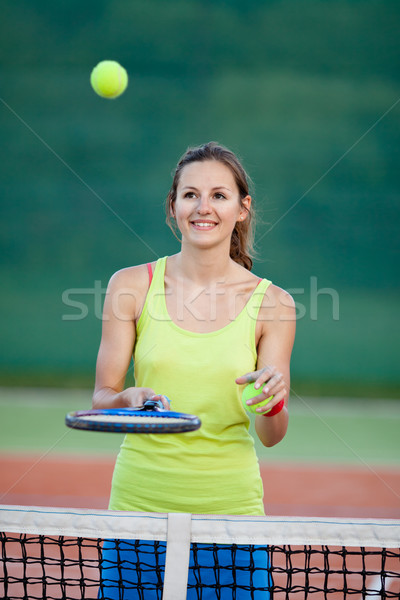 pretty, young female tennis player on the tennis court  Stock photo © lightpoet