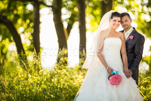 Portrait of a young wedding couple on their wedding day Stock photo © lightpoet