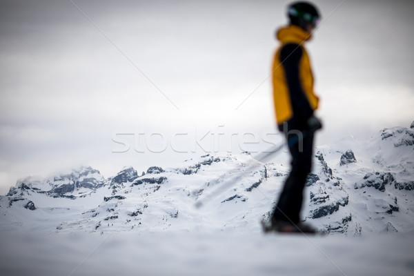 Skier skiing downhill in high mountains  Stock photo © lightpoet