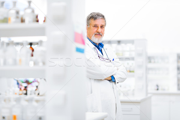 Senior male researcher carrying out scientific research in a lab Stock photo © lightpoet