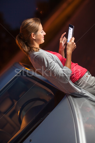 Pretty, female driver using her tablet computer Stock photo © lightpoet