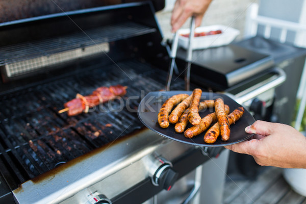 BBQ with sausages and red meat on the grill  Stock photo © lightpoet
