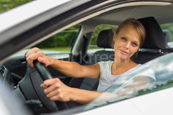 Young woman driving her car, on her way home from work Stock photo © lightpoet