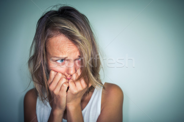 Young woman suffering from a severe depression, anxiety/sudden f Stock photo © lightpoet