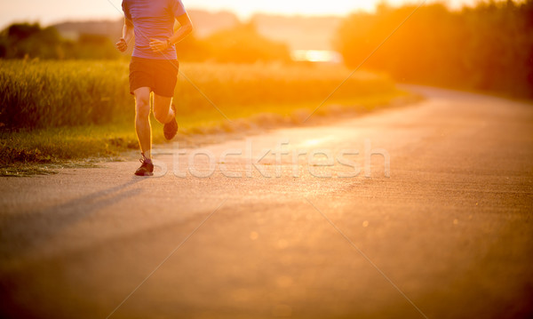 Male athlete/runner running on road Stock photo © lightpoet