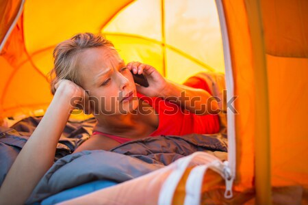 Pretty, young woman camping outdoors, lying in the tent Stock photo © lightpoet