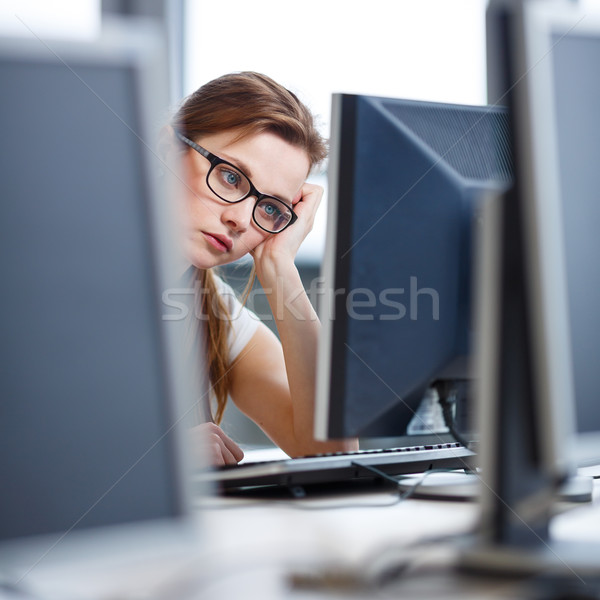 довольно женщины студент глядя экране Сток-фото © lightpoet