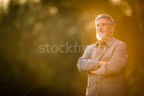 Portrait of a senior man outdoors, walking in a park Stock photo © lightpoet