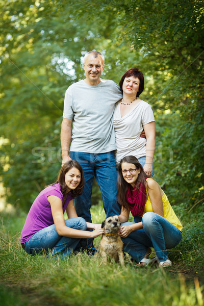 Family portrait - Family of four with a cute dog outdoors Stock photo © lightpoet