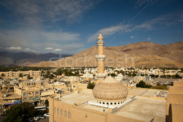 Stunning view of the city of Nizwa surrounded by mountains Stock photo © lightpoet