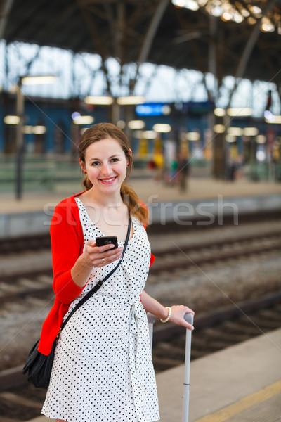 Csinos fiatal nő vasútállomás nő város vonat Stock fotó © lightpoet