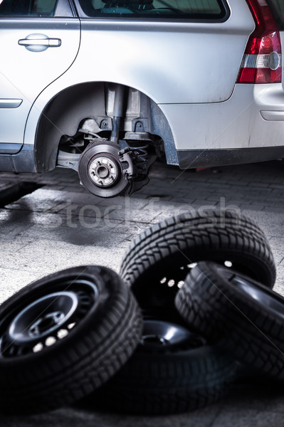mechanic changing a wheel of a modern car (shallow DOF; color to Stock photo © lightpoet