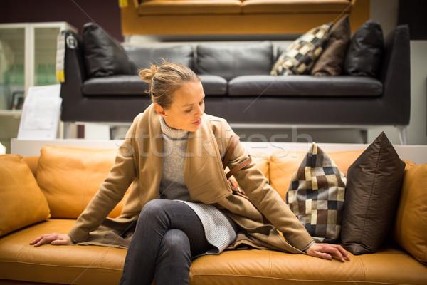 Csinos fiatal nő választ helyes bútor lakás Stock fotó © lightpoet