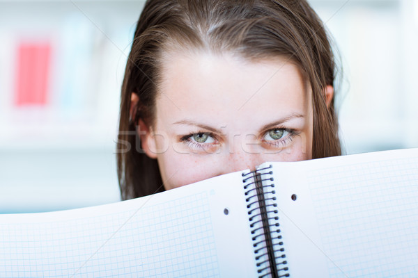 pretty female college student studying in the university library Stock photo © lightpoet