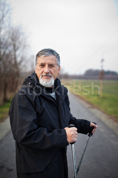 Stock photo: Senior man nordic walking, enjoying the outdoors, the fresh air,