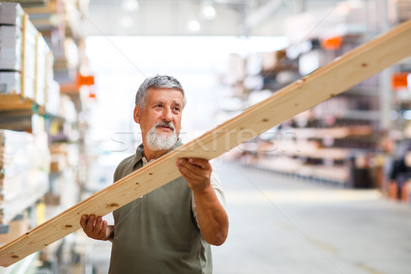 Man choosing and buying construction wood in a  DIY store Stock photo © lightpoet