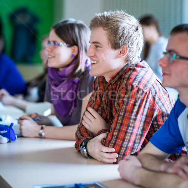 Stock photo: College students sitting in a classroom during class (shallow DO