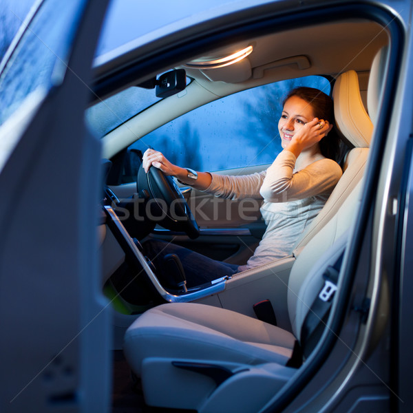 Pretty young woman driving her brand new car  Stock photo © lightpoet