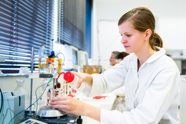 Portrait of a female researcher carrying out research in a chemi Stock photo © lightpoet
