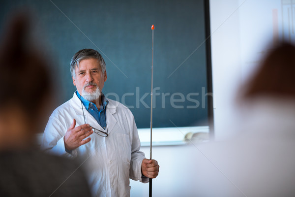 Senior chemistry professor giving a lecture Stock photo © lightpoet