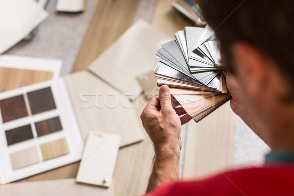 Man chosing the right flooring for his house/appartement Stock photo © lightpoet