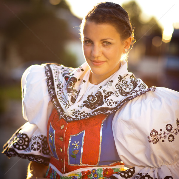 young woman in a richly decorated ceremonial folk dress Stock photo © lightpoet