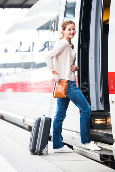 Pretty young woman boarding a train (color toned image) Stock photo © lightpoet